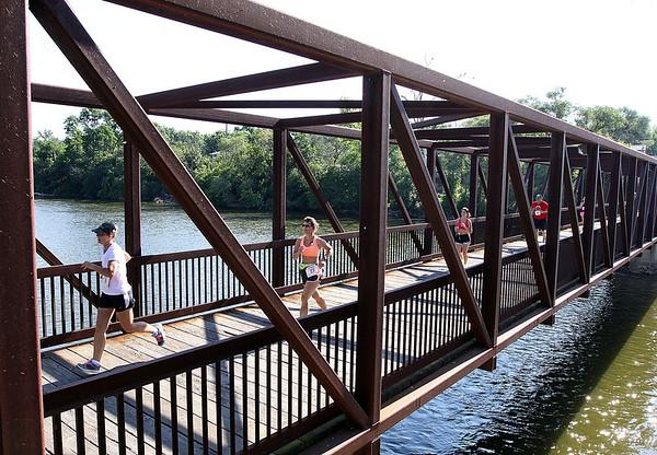 Jeff Krage – For Shaw Media<br /> Saturday's Windmill Whirl 5K race crosses the Fox River in downtown Batavia.<br /> Batavia 7/13/13