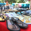 John and Kathi Riscossa of Phoenix, Arizona, sell arch supporting sandals and accessories from their booth at the Windmill City Festival Craft Fair and Flea Market  in downtown Batavia on Saturday. The Riscossas originally owned a video store in downtown Batavia, but relocated to Phoenix 10 years ago.