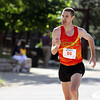 Jeff Krage – For Shaw Media<br /> Colin Young of Mt. Prospect nears the finish line during Saturday's Windmill Whirl 5K race in downtown Batavia. Young took first place.<br /> Batavia 7/13/13