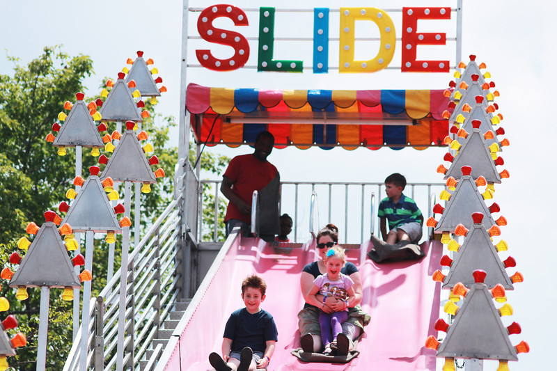 Festival goers slide down the giant slide at the Windmill City Festival Sunday in downtown Batavia. Sunday was the final day of the three day festival in Batavia.