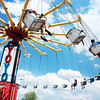 Festival goers spin around on the the YOYO Windy City Amusements ride during the Windmill City Festival in Batavia Sunday.