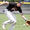Jeff Krage - For Shaw Media<br /> Batavia second baseman Jeremy Schoessling reaches for a ground ball during Tuesday's game against visiting Crystal Lake South.<br /> Batavia 7/16/13