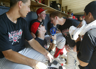 H. Rick Bamman - hbamman@shawmedia.com Huntley's Dillon Dell'Aquila (center) shares his misting fan with teammates in the dugout Thursday, July 18, 2013 during the Lake Park Regional final of the Phil Lawler baseball Classic in Roselle.