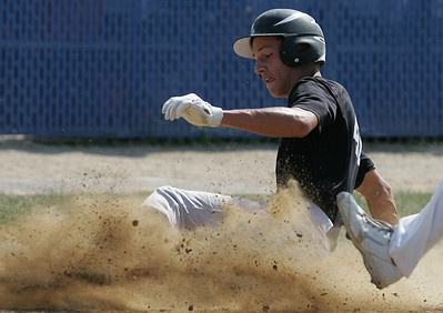 H. Rick Bamman - hbamman@shawmedia.com Huntley's Jake Ciskowski slides into home to score on a Lake Park wild pitch in the top of the third inning in the Lake Park Regional final of the Phil Lawler baseball Classic.