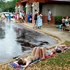 Sisters (left to right) Caden, 9, Camryn, 8, and Cira Lee, 5, wait out a lightning delay during a hot day Thursday at Sunset Pool in Geneva.