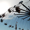 Riders fly by on the Yo-Yo swings ride during the second day of the Kane County Fair in St. Charles Thursday.