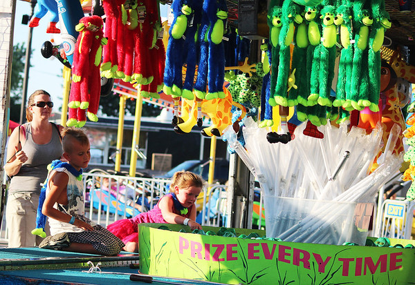 Festival goers play a game during the second day of the Kane County Fair in St. Charles Thursday.