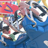 Ryan Boe, 7, of Geneva glides on a ride during the second day of the Kane County Fair in St. Charles Thursday.