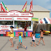 Patrons walk past some of the food options during the second day of the Kane County Fair in St. Charles Thursday.