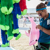 Erik Anderson - For the Kane County Chronicle<br /> Fair employee, Melissa Jane Milev, 23, from South Africa uses a hose to blow up a pink dolphin at her stand while waiting for customers during the Kane County Fair and Festival in St. Charles on Saturday, July 20, 2013. The fair is held on July 17-21 in St. Charles.