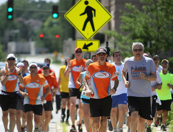 Jeff Krage – For Shaw Media<br /> Steve Spear of St. Charles, along with St. Charles Mayor Raymond Rogina, run north on Rt. 31 toward Dick Pond Athletics on Saturday. <br /> St. Charles 7/20/13