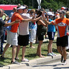 Jeff Krage – For Shaw Media<br /> Steve Spear of St. Charles is greeted by supporters as he nears Dick Pond Athletics on Saturday. <br /> St. Charles 7/20/13