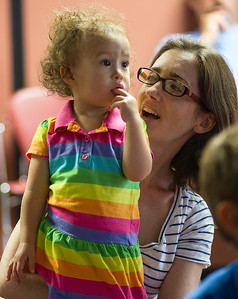 Kyle Grillot - kgrillot@shawmedia.com   Sharon Snow holds her daughter Claire Snow, 1, during the Animals of McHenry County presentation at the Crystal Lake Public Library given by McHenry County Conservation District Wildlife Resource Specialist Beth Gunderson Tuesday, July 23, 2013. The presentation gives children and parents the opportunity to learn more of the history of animals in the region as well as meet a special visitor, Rae the Blanding's turtle.
