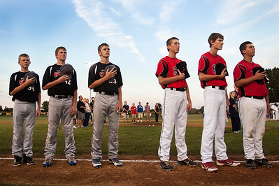 Kyle Grillot - kgrillot@shawmedia.com   Members of the Illinois Stix (left) and the Crystal Lake Bombers listen while the national anthem is played before the start of their MCYSA games against the Puerto Rico and Brazil Monday, July 29, 2013.