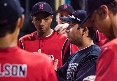 Kyle Grillot - kgrillot@shawmedia.com   Crystal Lake Bombers' head coach Mike Krueger talks with  his team before the start of the third inning of the MCYSA game against the Puerto Rico Apaches Monday, July 29, 2013.