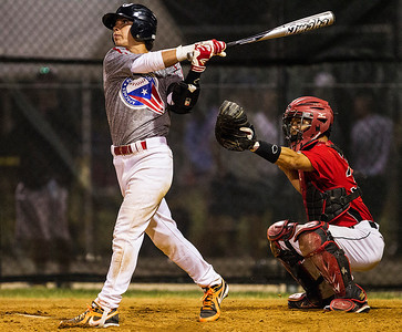 Kyle Grillot - kgrillot@shawmedia.com   Puerto Rico's Jaret Delgado (left) hits a could ball during the third inning of the MCYSA game against the Puerto Rico Apaches Monday, July 29, 2013.
