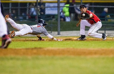 Kyle Grillot - kgrillot@shawmedia.com   Crystal Lake Bombers' Alex Bahnick (right) catches the ball to tag out Puerto Rico's Jaret Delgado during the third inning of the MCYSA game against the Puerto Rico Apaches Monday, July, 29, 2013.