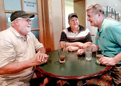 Sarah Nader - snader@shawmedia.com Ken Koehler (left) of Crystal Lake and Dennis Adams of McHenry talk with GOP gubernatorial candidate Dan Rutherford during Wednesday's McHenry County Republican Party golf outing at the McHenry County Club July, 17, 2013.