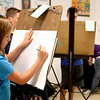 Audry Forester begins her sketch of the still life at Monday's pencil drawing class at Water Street Studios in Batavia. The class is held weekly and allows kids age 10 to 15 to explore the art of pencil drawing.