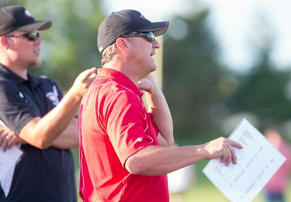 Aurora Christian Head Coach Dave Beebe calls a play against Marmion during the Aurora Christian 7 on 7 competition at Aurora Christian High School in Aurora , IL on Tuesday, July 08, 2014 (Sean King for Shaw Media)