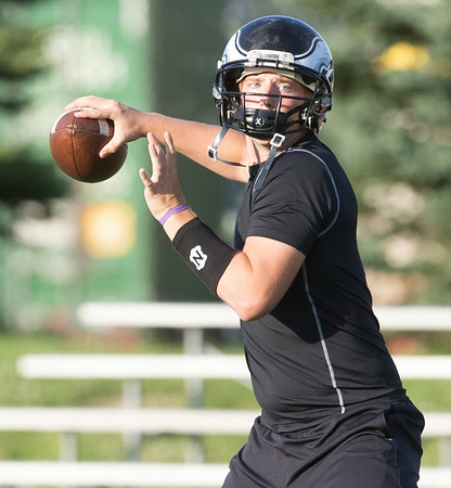 Aurora Christian Quarterback Austin Bray Drops Back to pass against Marmion during the Aurora Christian 7 on 7 Competition at Aurora Christian High School in Aurora , IL on Tuesday, July 08, 2014 (Sean King for Shaw Media)