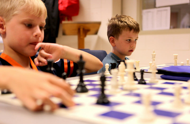 Pierce Cooper and Ben Schmidt engage in games of  chess at Geneva High School's Chess Camp. The week long camp taught students from 1st to 8th grade the basic moves and tactics of chess.