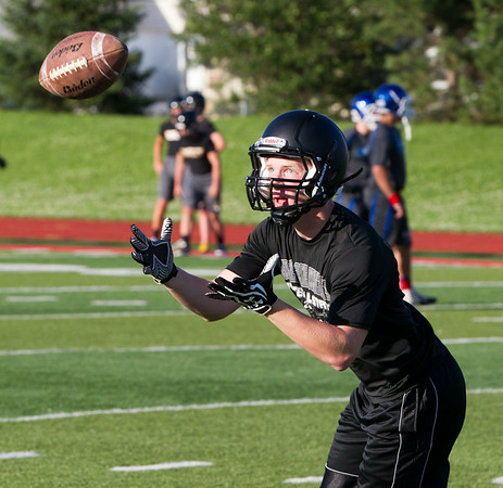 Kaneland Linebacker Brandon Kigyos catches a pass during drills prior to the start of the Aurora Christian 7 on 7 Competition at Aurora Christian High School in Aurora , IL on Tuesday, July 08, 2014 (Sean King for Shaw Media)