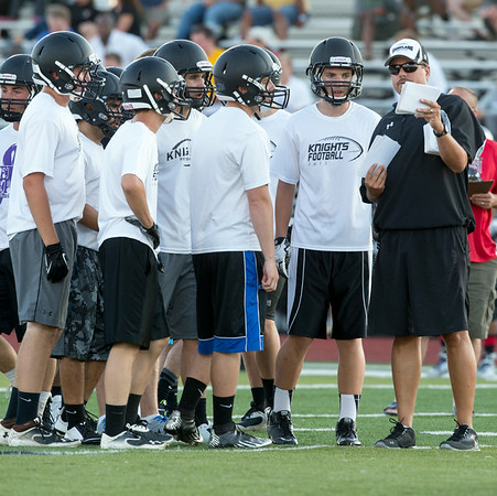 Kaneland Head Football Coach Tom Fedderly calls a play against Marmion during the Aurora Christian 7 on 7 Competition at Aurora Christian High School in Aurora , IL on Tuesday, July 08, 2014 (Sean King for Shaw Media)