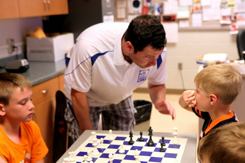 Steve Whitman instructs students at last week's chess camp. The camp was held at Geneva High School and offered the chance for students in 1st to 8th grade to learn the strategy and basics behind the game of chess.