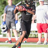Aurora Christian Wide Receiver Jacolby Maxwell runs after the catch against Marmion during the Aurora Christian 7 on 7 Competition at Aurora Christian High School in Aurora , IL on Tuesday, July 08, 2014 (Sean King for Shaw Media)