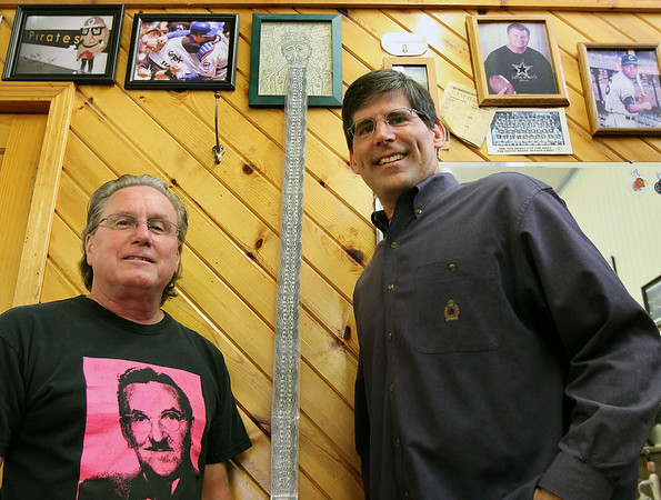 Jeff Krage – For Shaw Media<br /> Avenue Two Barber Shop's Frank Pavlek, left, and longtime customer Scott Comperda, both of St. Charles, stand Saturday by a long beard, which shows in years the length from the Chicago Cubs last championship. <br /> St. Charles 7/5/14