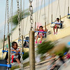 LaMiya House, 5, rides the swings with her cousins at the Kane County Fair in St. Charles on Saturday.