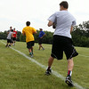 Jeff Krage – For Shaw Media<br /> Former NFL quarterback and 1979 St. Charles High School graduate Randy Wright watches as athletes run a drill during the Trickey-Wright QB/Receivers camp on Saturday at St. Charles North High School.<br /> St. Charles 7/19/14