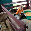 Luca Chaddock, 4, of Sleepy Hollow, plays in the Young Farmers Barn at the Kane County Fair in St. Charles on Saturday.