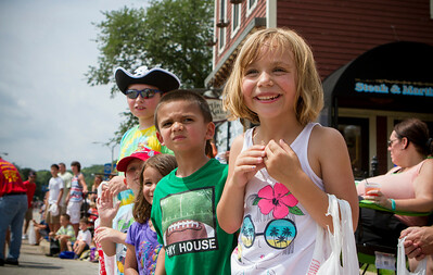 "Mike Greene - For Shaw Media Lexi Miller, right, 6 of Algonquin, reacts to a Minions-themed float as Luke Botello, 5 of Crystal Lake, looks down the street for upcoming floats during the Algonquin Founders' Days ""Pirates on the Fox"" parade Saturday, July 25, 2015 in Algonquin. Founders' Day events for Sunday include the Founders' Run, Illinois State Regional Battle of the Bands, Family Olympics, and Fireworks."