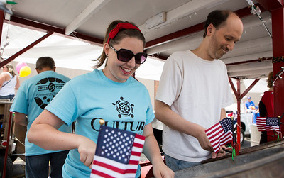 Mike Greene - For Shaw Media  Amanda Krzyzak, of Wonder Lake, and Joey Zymonas, of Cary, warm up with Potts & Pans Steelband before the start of the annual Crystal Lake Independence Day Parade Sunday, July 3, 2016 in Crystal Lake.
