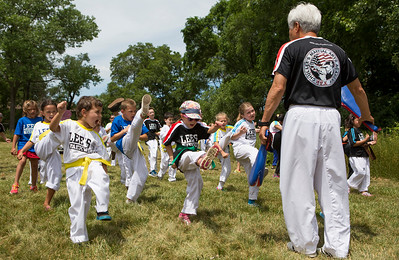 Mike Greene - For Shaw Media  Members of Lee's Tae Kwon Do warm up before the start of the annual Crystal Lake Independence Day Parade Sunday, July 3, 2016 in Crystal Lake.