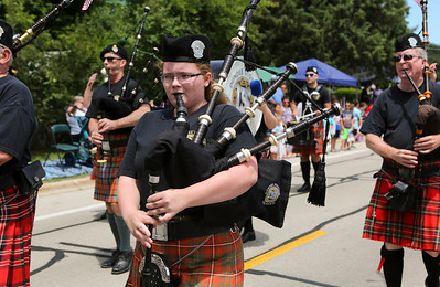 Mike Greene - For Shaw Media  Members of the Dundee Scottish Pipe Band perform during the annual Crystal Lake Independence Day Parade Sunday, July 3, 2016 in Crystal Lake.