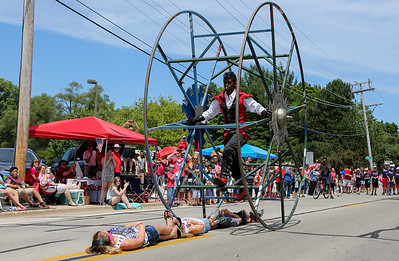 Mike Greene - For Shaw Media  Sam & The Giant Wheel rolls over members of the crowd during the annual Crystal Lake Independence Day Parade Sunday, July 3, 2016 in Crystal Lake.