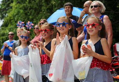 Mike Greene - For Shaw Media  From right, Chloe, Ashley, and Hannah Cross, 8 of Crystal Lake, cheer during the annual Crystal Lake Independence Day Parade Sunday, July 3, 2016 in Crystal Lake.