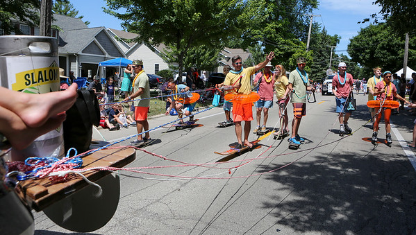 Mike Greene - For Shaw Media  Members of the Crystal Lake Brewery float are towed behind the float during the annual Crystal Lake Independence Day Parade Sunday, July 3, 2016 in Crystal Lake.