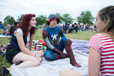 Mike Greene - For Shaw Media  Andrea Freeman, left 17 of Woodstock, and Isaac Thayer, of Woodstock, talk with friends during the annual Woodstock fireworks Monday, July 4, 2016 at Emricson Park in Woodstock.