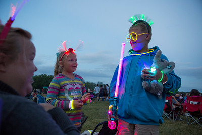 Mike Greene - For Shaw Media  Chloe, 7, and Kyle Bauman, 9, show of their glow-in-the-dark items during the annual Woodstock fireworks Monday, July 4, 2016 at Emricson Park in Woodstock.