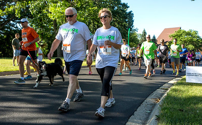 Mike Greene - For Shaw Media  Participants walk and run near the starting line during the sixth annual Run for Hope event Saturday, July 9, 2016 at Grace Lutheran Church in Woodstock. Funds from the event are donated to The Cure Starts Now, which helps fight childhood cancer.