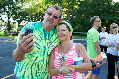 Mike Greene - For Shaw Media  Bill Seger, left, poses for a photo with Deb Fuller before the start of the sixth annual Run for Hope event Saturday, July 9, 2016 at Grace Lutheran Church in Woodstock. Funds from the event are donated to The Cure Starts Now, which helps fight childhood cancer.