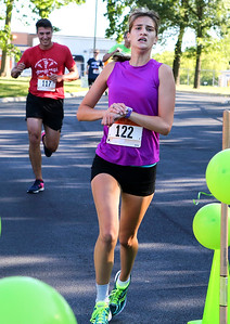 Mike Greene - For Shaw Media  Sarah Roberts, 16 of Lake in the Hills, crosses the finish line during the sixth annual Run for Hope event Saturday, July 9, 2016 at Grace Lutheran Church in Woodstock. Funds from the event are donated to The Cure Starts Now, which helps fight childhood cancer.