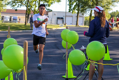 Mike Greene - For Shaw Media  Julio Arellano, 15 of Woodstock, is the first to cross the finish line during the sixth annual Run for Hope event Saturday, July 9, 2016 at Grace Lutheran Church in Woodstock. Funds from the event are donated to The Cure Starts Now, which helps fight childhood cancer.