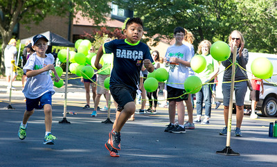 Mike Greene - For Shaw Media  Hector Arellano, 10 of Woodstock, chugs towards the finish line during the children's portion of the sixth annual Run for Hope event Saturday, July 9, 2016 at Grace Lutheran Church in Woodstock. Funds from the event are donated to The Cure Starts Now, which helps fight childhood cancer.