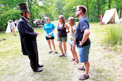 Candace H. Johnson Max Daniels, of Wheaton, as President Abraham Lincoln, talks with Bev and John McKeown, of Island Lake and their daughters, Sarah,16, and Katie, 13, during Civil War Days at the Lakewood Forest Preserve in Wauconda.