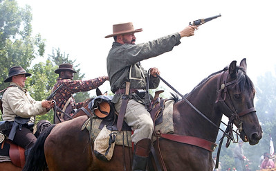 Candace H. Johnson Dave Gordy, of Ottumwa, Iowa with the 8th Texas Calvary Company G gets ready to shoot in the Battle of Big Bethel during Civil War Days at the Lakewood Forest Preserve in Wauconda.